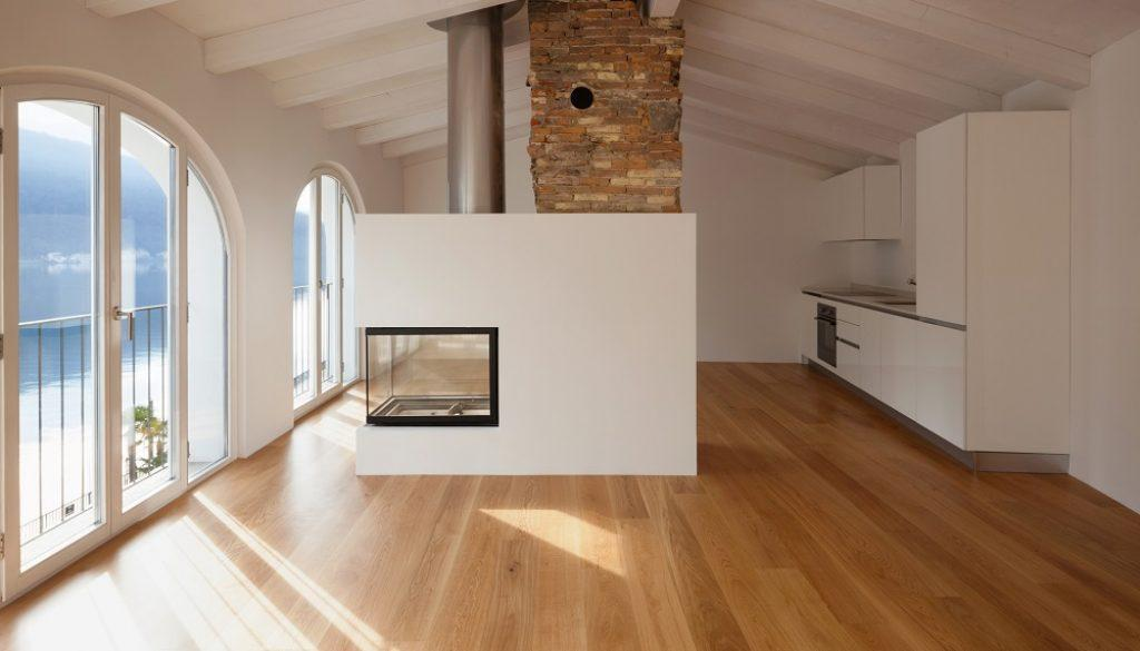 Modern living room with fireplace in the middle